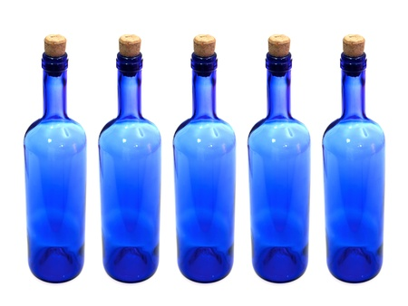 tare: Glass bottles isolated against a white background
