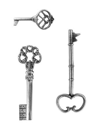 skeleton key: Vintage brass keys isolated against a white background