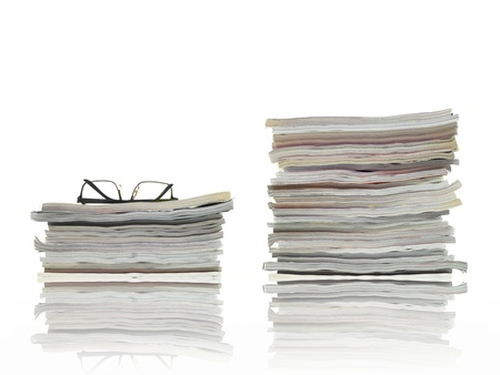 informed: A stack of magazines isolated against a white background