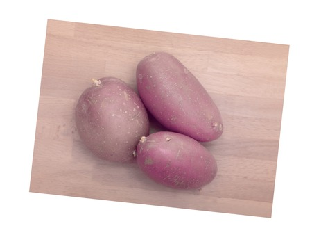 A close up shot of potatoes on a chopping board photo