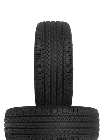 A black rubber tyre isolated against a white background photo
