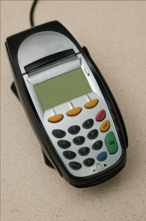A eftpos machine on a plain background photo