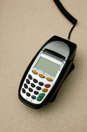 A eftpos machine on a plain background photo