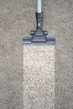 carpet clean: A vacuum cleaner isolated against a white background