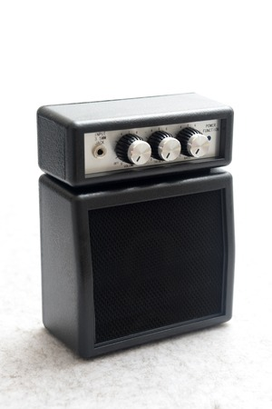 An amplifier isolated against a plain backgrouns photo