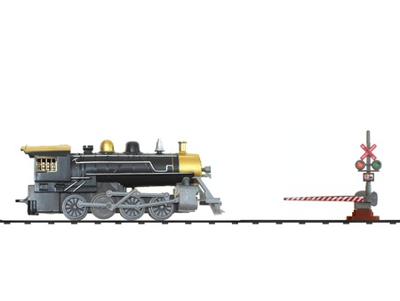 A toy train isolated against a white background photo