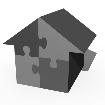 A conceptual jigsaw house on a white background photo