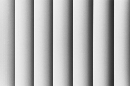 verticals: A close up shot of hardwood blinds silhouetted Stock Photo