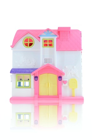 A close up shot of a toy doll house photo
