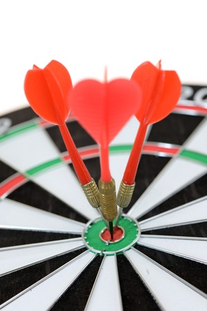 darts flying: A close up shot of a Dart Board