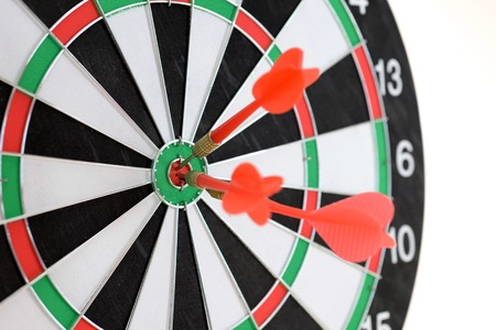 A close up shot of a Dart Board photo