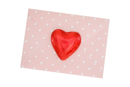 A close up shot of valentine envelope with a heart photo