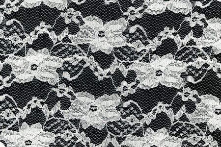 A close up shot of lace fabric photo