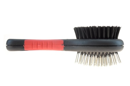 A close up shot of a dogs grooming brush photo