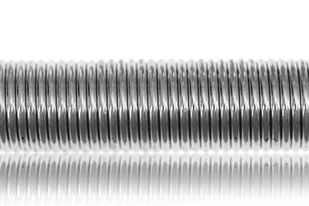 A close up shot of a coil spring photo