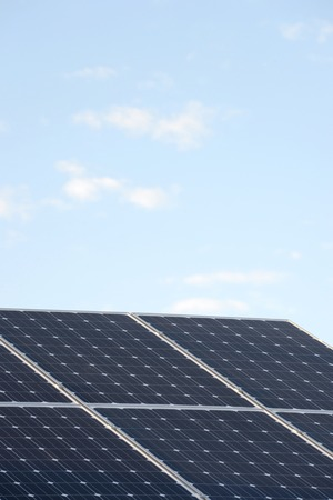 A shot of solar panels of a tiled roof photo