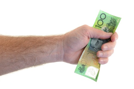 corporate greed: A close up shot of cash in hand