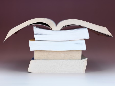 A close up shot of a pile of books photo