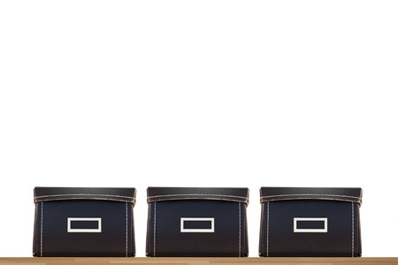 storing: Storage boxes isolated on a wooden shelf