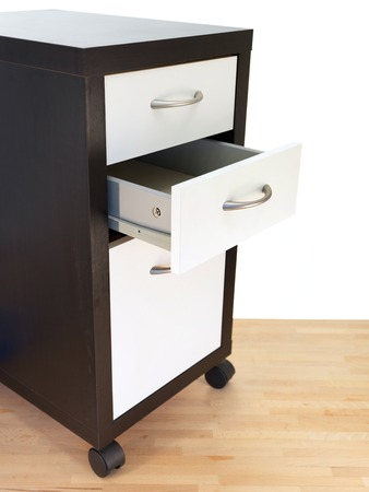 A close up shot of a set of office drawers photo