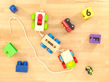 kidsroom: A close up shot of toys scattered over a wooden floor