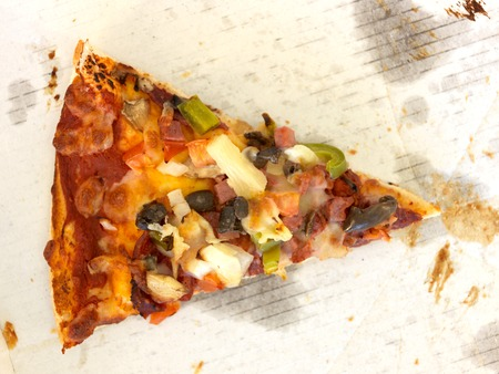 leftover: A close up shot of a takeaway pizza