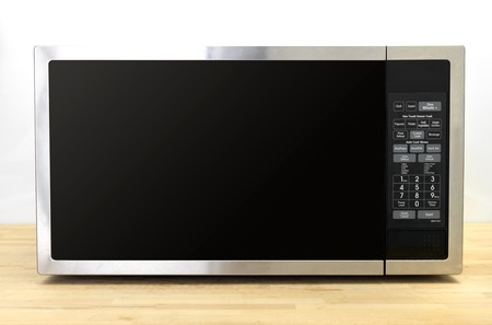 defrost: A shot of a kitchen microwave oven Stock Photo