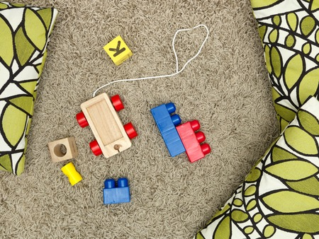 babyroom: A close up shot of toys scattered on the floor Stock Photo