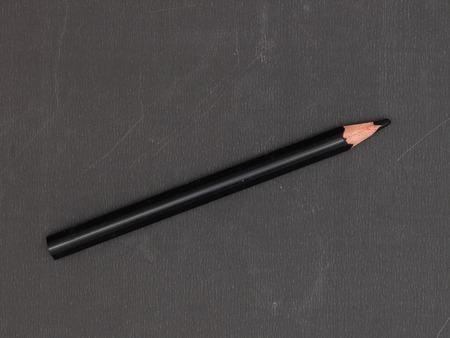 gradation art: A close up shot of a black colouring pencil