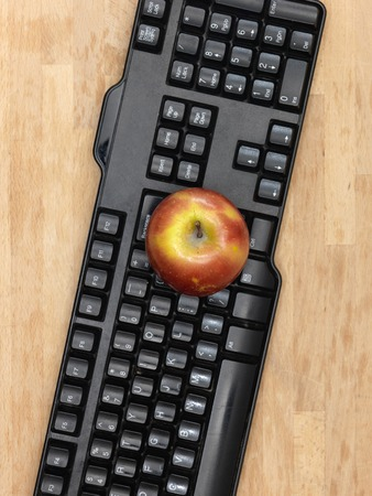 work station: A conceptual image of an apple at a work station Stock Photo