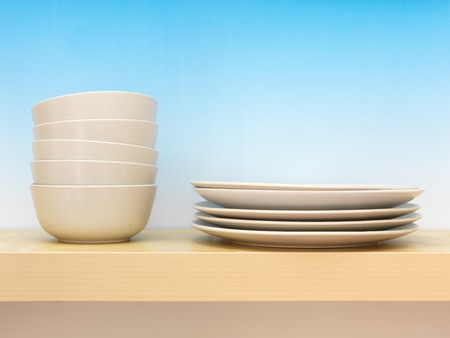homeware: A close up photo of a wooden shelf with crockery Stock Photo