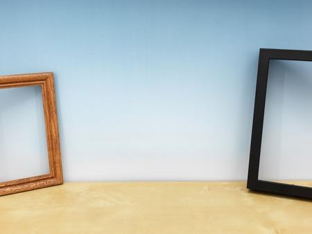 book concept: photo frames on a wooden shelf