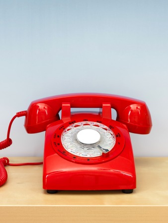 dial plate: A close up photo of a red rotary phone Stock Photo