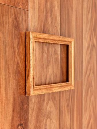mocks: A photo frame on a wooden shelf