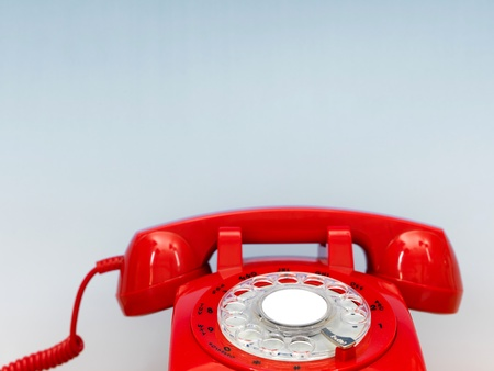 dialplate: A close up photo of a red rotary phone Stock Photo