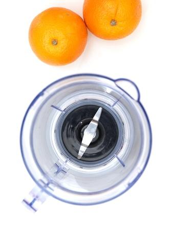 liquidiser: A close up photo of a juice blender and oranges
