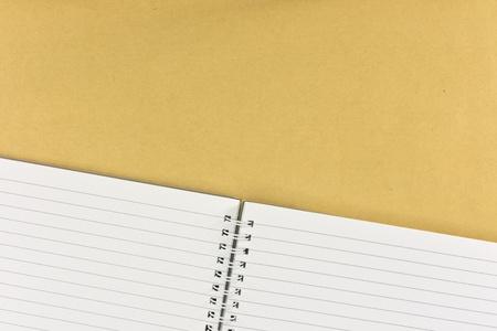 A studio photo of note book up close