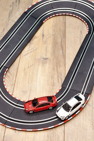 red sports car: A studio photo of a slot car race set Stock Photo