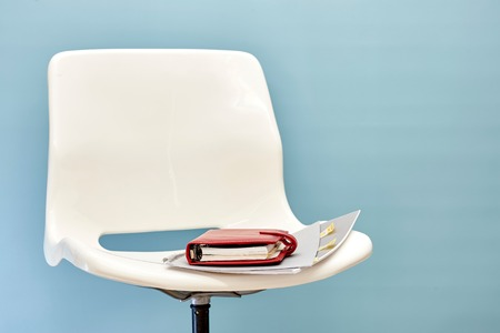 swivel: A studio photo of a white swivel chair Stock Photo
