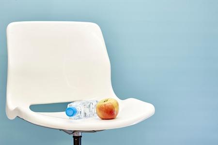 swivel chairs: A studio photo of a white swivel chair Stock Photo