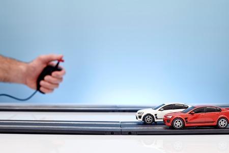 A studio photo of a slot car race set Standard-Bild