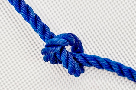 lashing: A studio photo of a rope knot Stock Photo