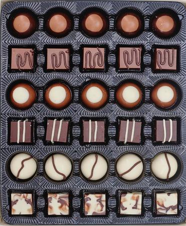 box of chocolates: A close up studio photo of box chocolates