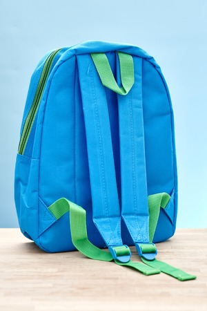 back pack: A studio photo of a school back pack