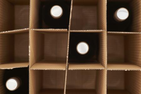 pinot: A studio photo of a cardboard wine box