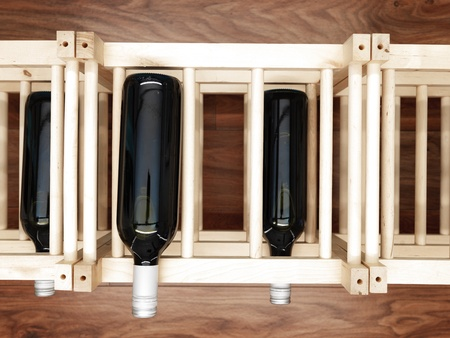 intoxicant: A studio photo of a wooden wine rack