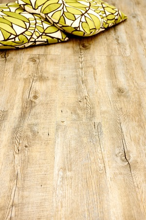 wooden floor: A close up photo of a wooden floor boards