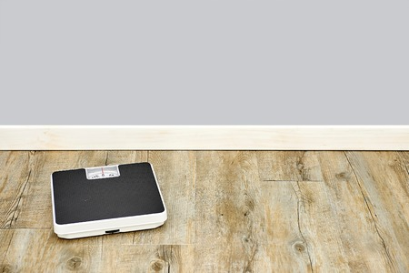 bathroom scale: A studio photo of a conceptual health and fitness photo Stock Photo