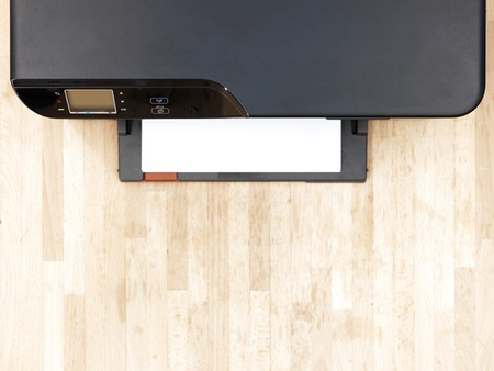 ink jet: A close up shot of a home document printer