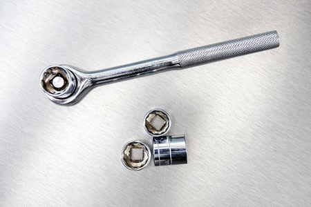socket wrench: A studio photo of a socket wrench